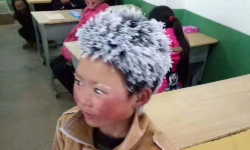Fotografado com cabelo e sobrancelhas congelados, chinês de 8 anos gera debate sobre pobreza no país
